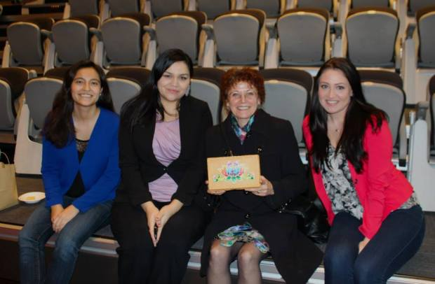 ILSA members Montana Cardinal, Catriona Dooley & Nicole Iaci are shown sitting with Jean Teillet after receiving her gift from ILSA (Made by all 3 students) during Indigenous Awareness Week 2015.